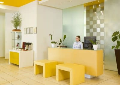Mamaison Residence Sulekova Bratislava_Reception-with-receptionist